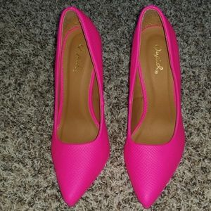 Neon pink heels